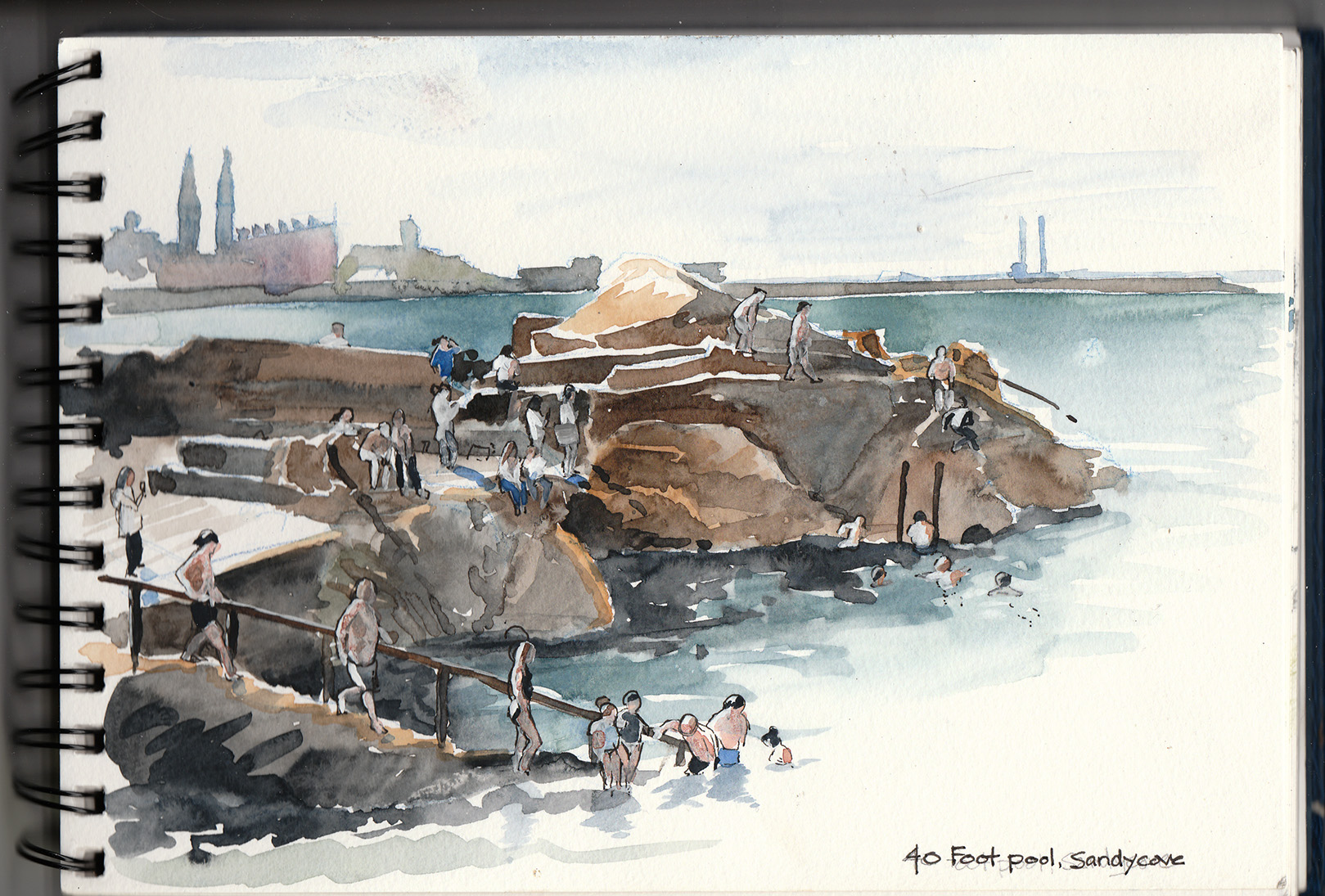 Sandycove's legendary swimming hole at 40 Foot Pool on a beautiful sunny July afternoon. Sketched in watercolour after a quick dip. Dun Loaghaire and Dublin in the background.