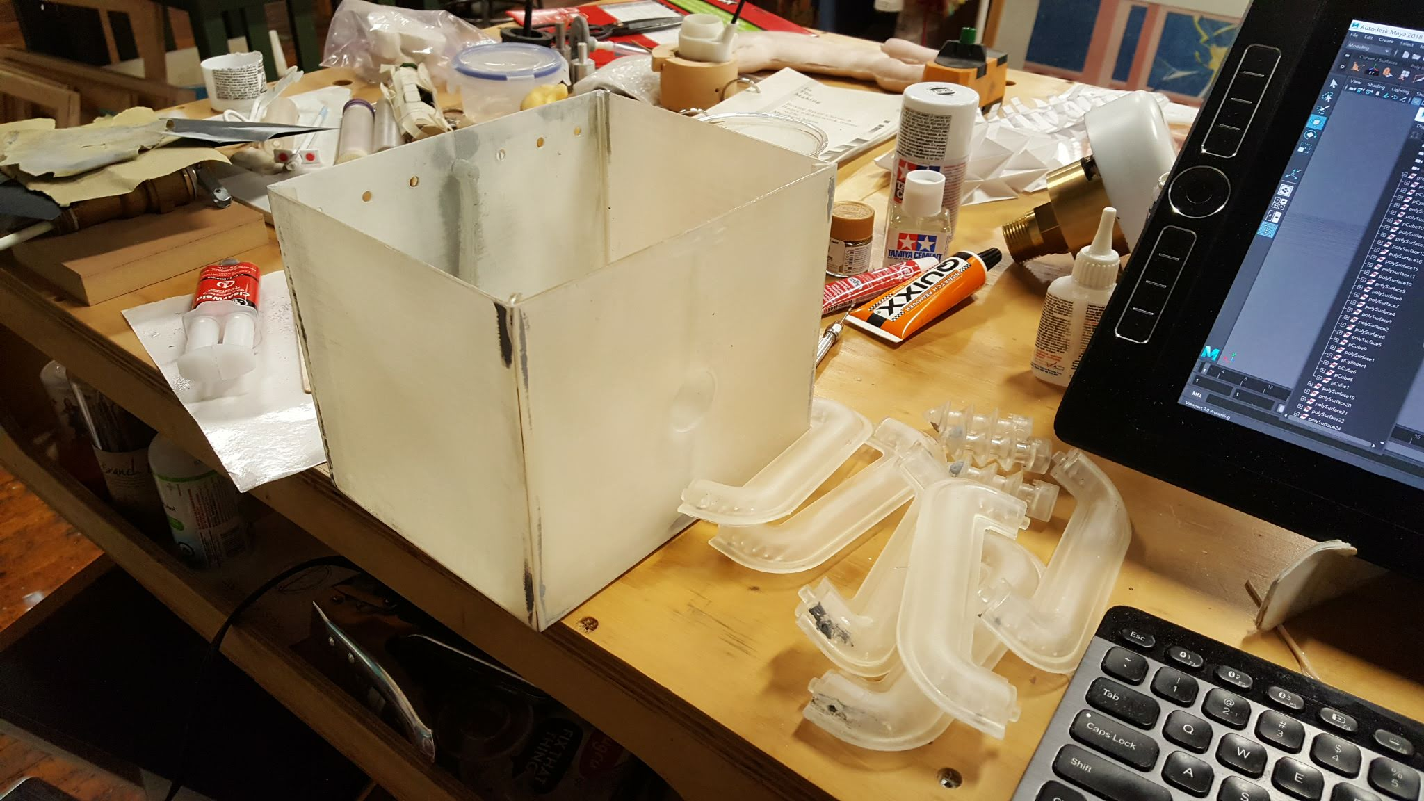 A wack of prints. While I printed the details I started gluing the panels of the transformer together. Gluing and filling and sanding.