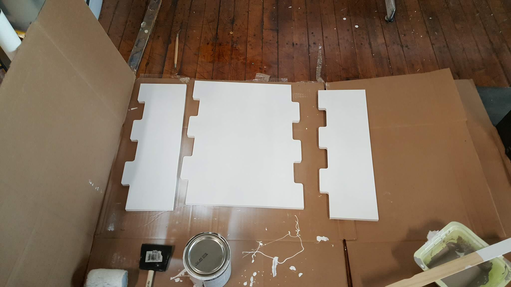 Painting the MDF base panels.