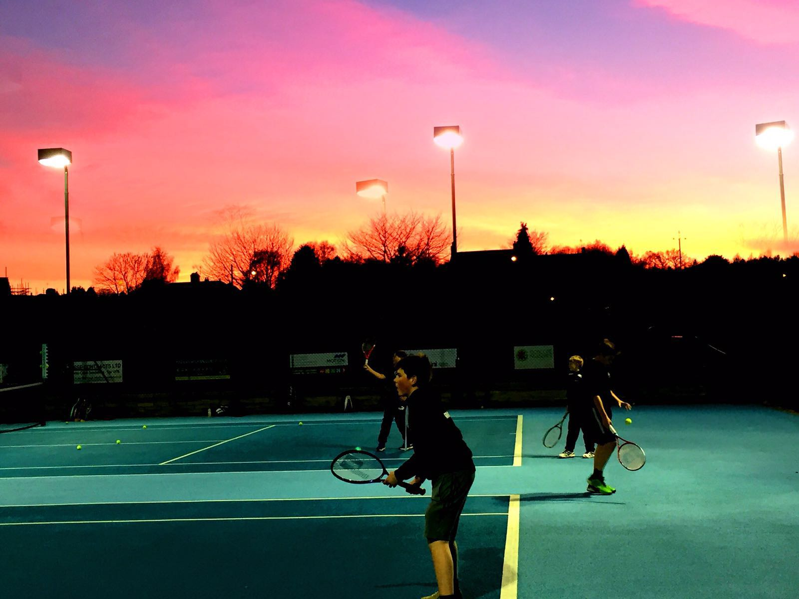 A gorgeous sunset sets a perfect backdrop for our junior coaching session. Photo credit to Tim!