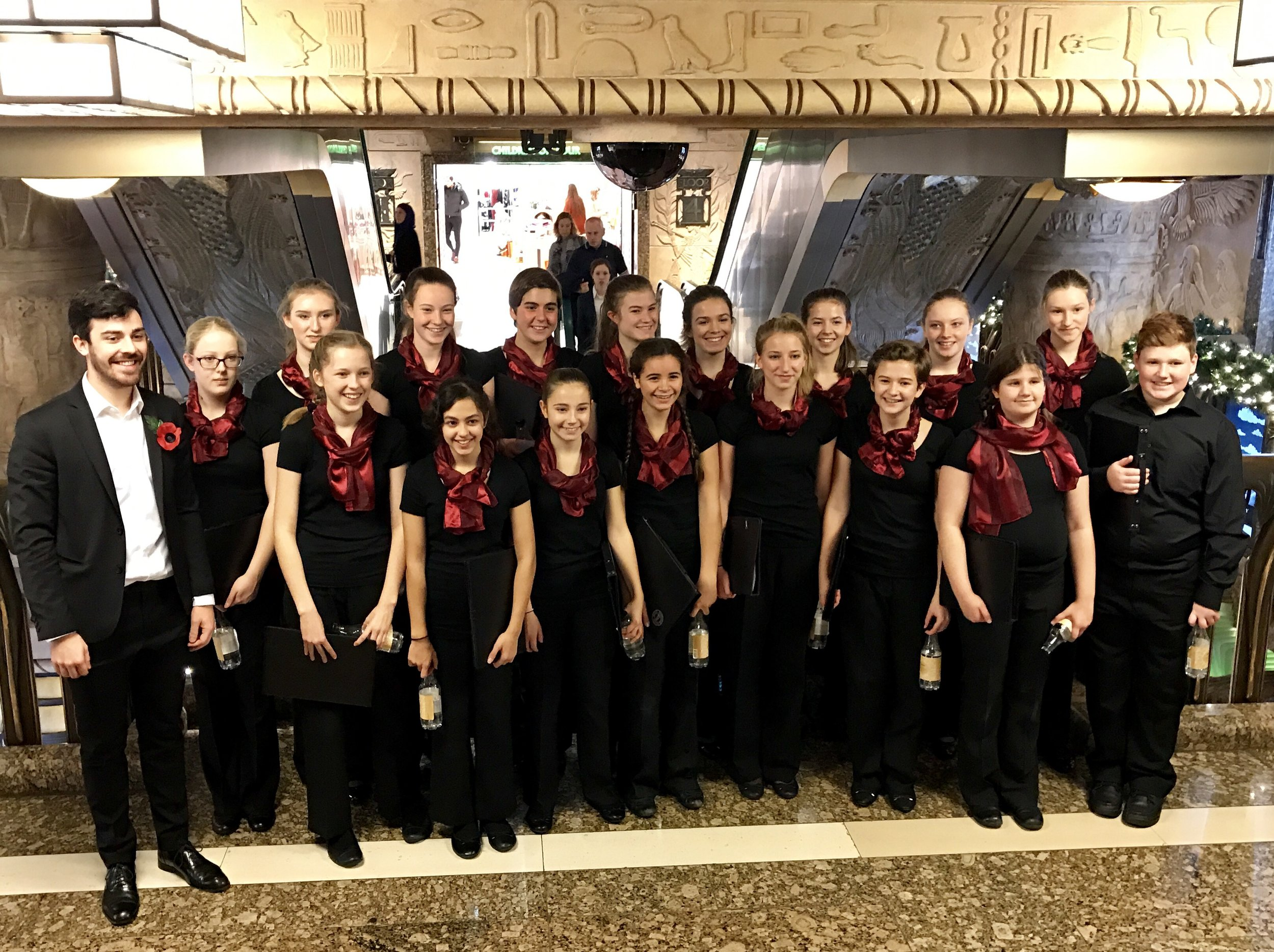 Patrick and the choir after singing carols between 4pm and 5pm at the Egyptian escalator in Harrods on 13th November.