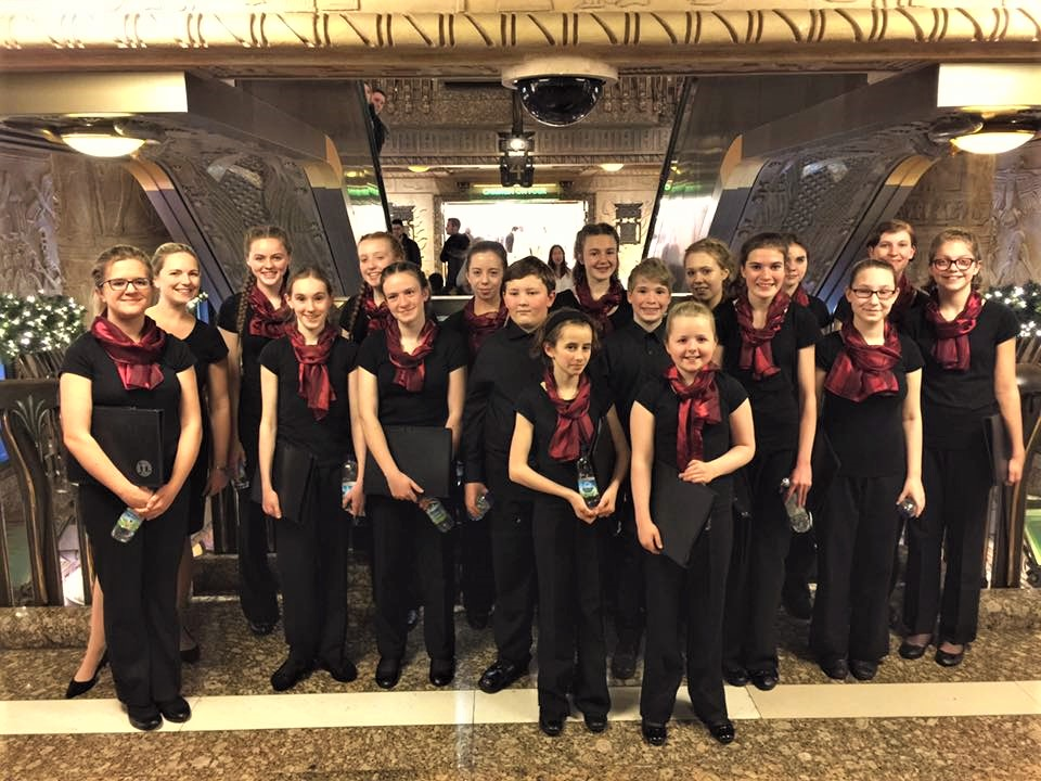 Jo and the choir after singing carols between 4pm and 5pm at the Egyptian escalator in Harrods on 20th November.