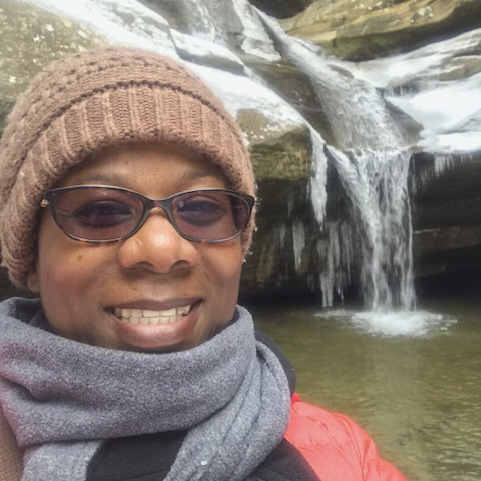 Kim Smith-Woodford  is an advocate for diversity, equity and inclusion in the outdoors. She frequently creates and facilitates events and conversations that engage people of color to embrace nature's presence while finding their joy. She's grateful that her love of nature and nature equity has landed her opportunities to meet wonderful people across the country that share similar passions. She leads outdoor community groups and youth hikes. She participates in community thought leader discussions and speaks on nature equity panels as well as to groups surrounding DEI in the outdoors and environmental stewardship. Through her consulting business, Journey On Yonder, her goal is to advance the narrative of diversity in the outdoors.  Kim's journey has taken her to some of the most amazing spots within the country including the Grand Canyon, Yosemite and Yellowstone National Parks. But you can often catch her trekking around in our local parks, hugging trees while taking a bazillion nature photos and selfies and most of all, creating black JOY in nature.  She enjoys life with her husband Kelvin and her three puppies, Zoe, Max and Tux.