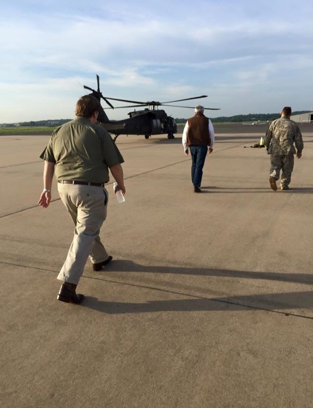 Leaving to survey flood damage with Gov. Asa Hutchinson, ADEM, National Guard, members of the legislature and press.