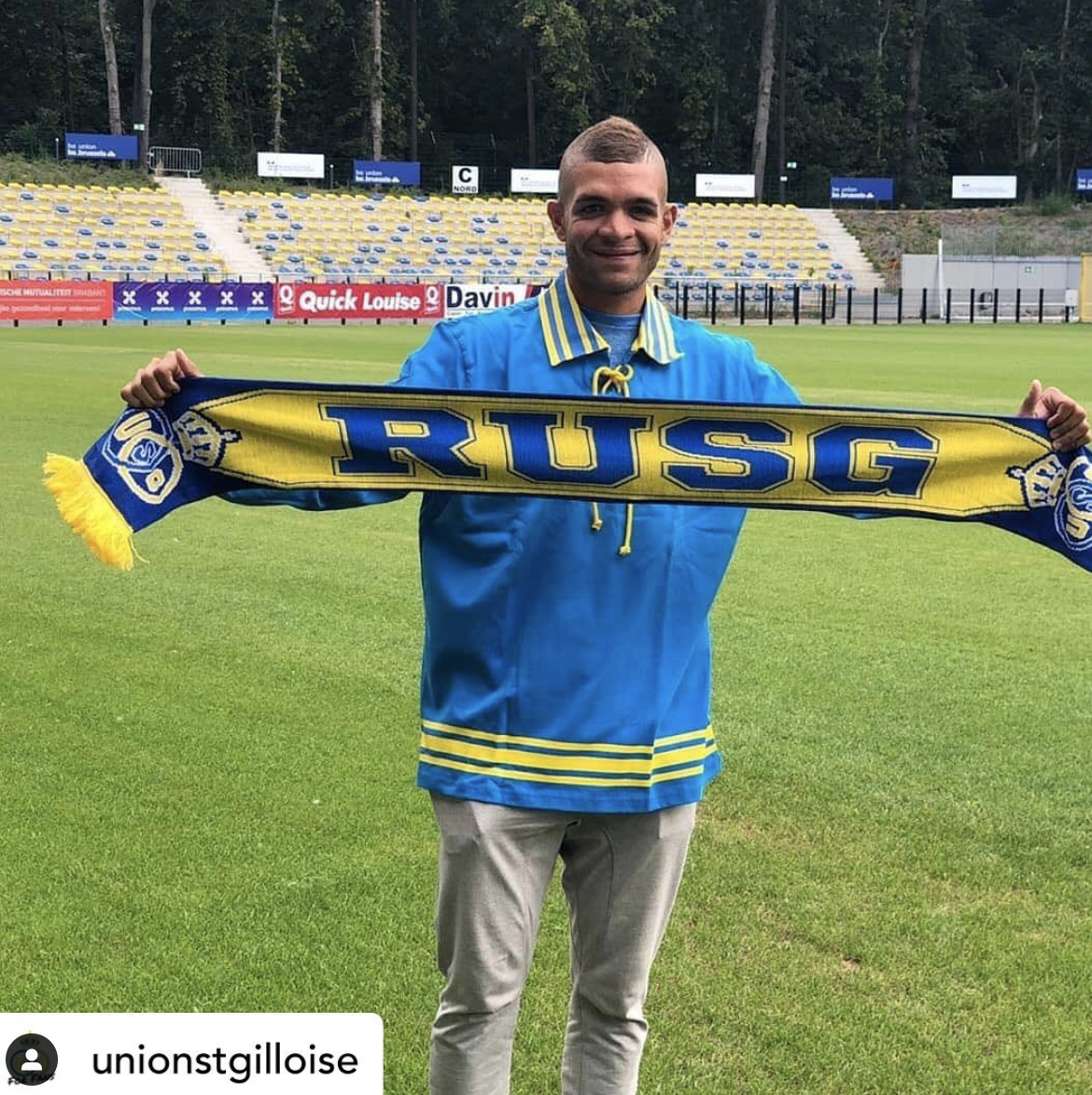 Mauricio Chejov holding up a Union scarf designed by nope design