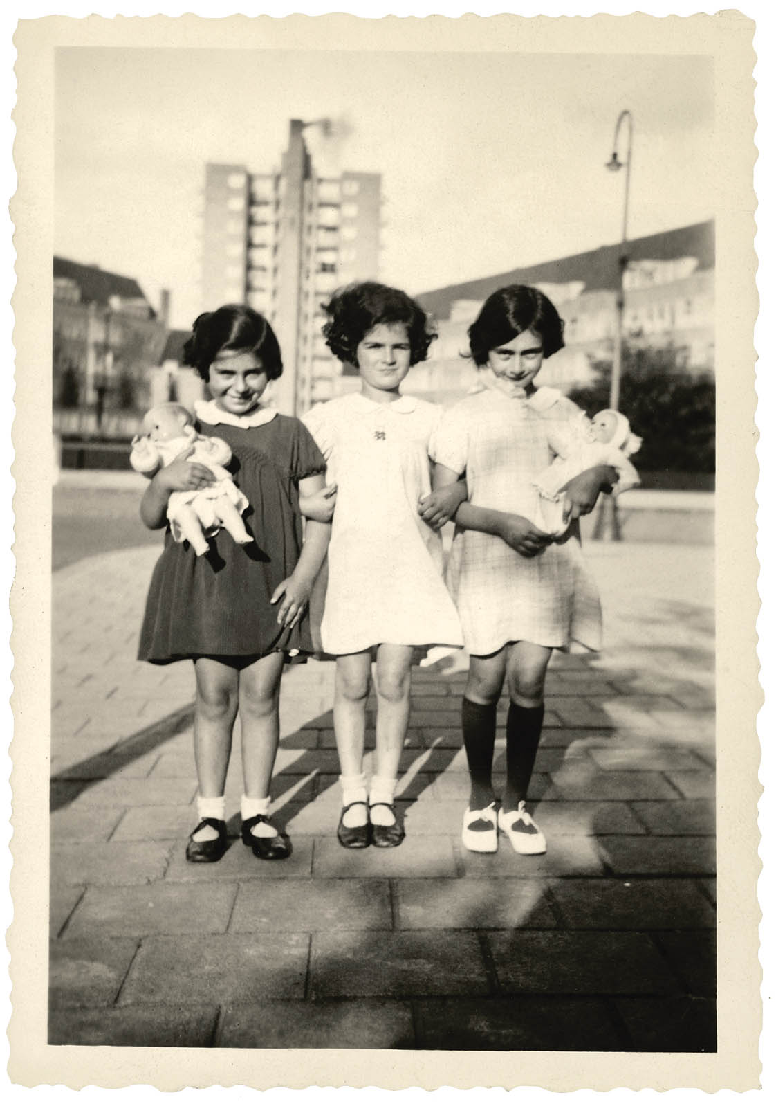 Anne Frank (right) at age 7 in 1936. With friends Eva Goldberg (left) and Sanne Ledermann (centre) August 1936.  (from p. 8 of  All About Anne  ©Anne Frank House)