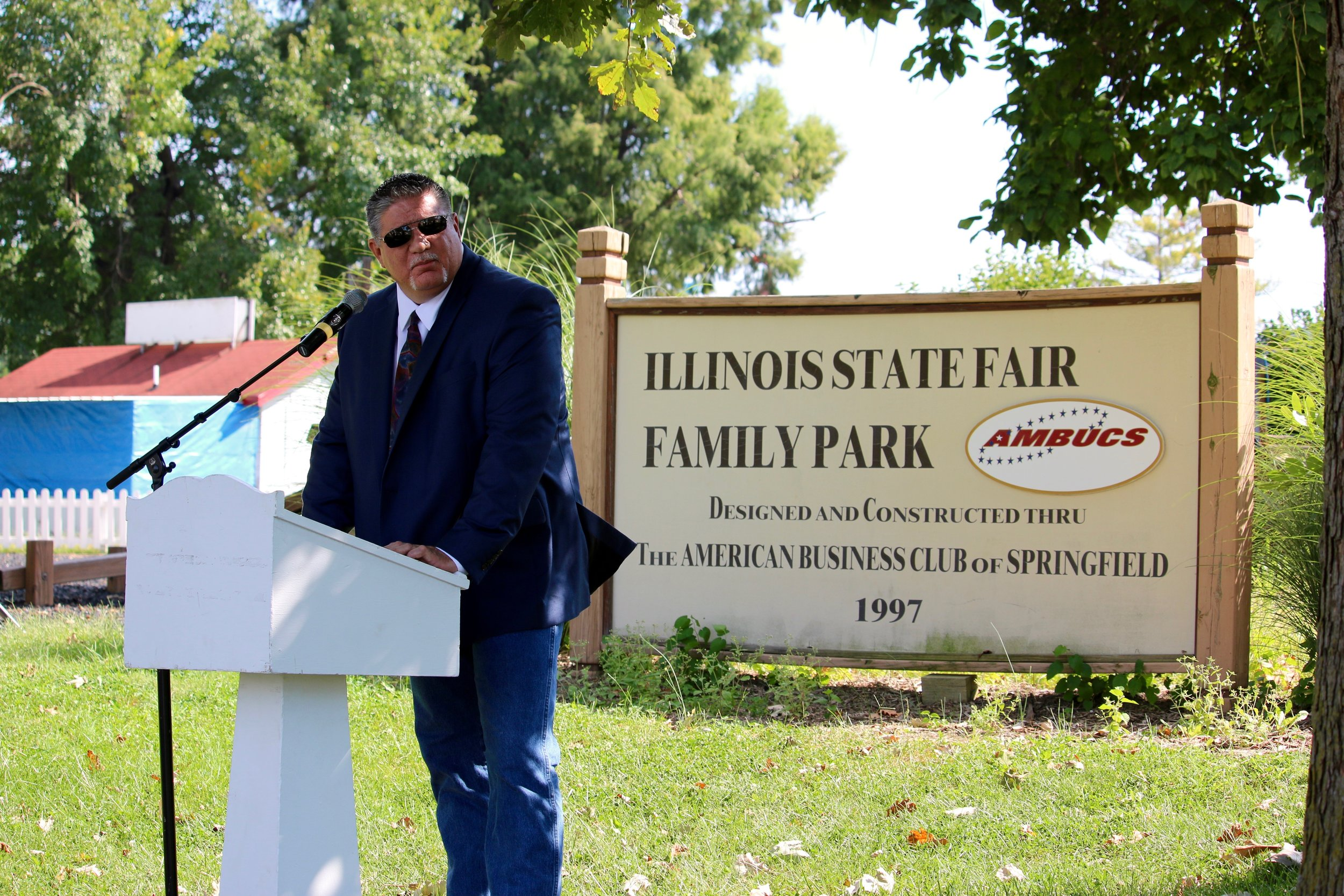 State Fair Manager, Kevin Gordon, gives remarks and thanks to local charities