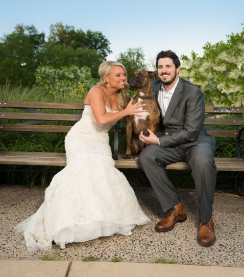 Abby and Ben Sgro with their dog, Caesar.