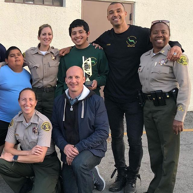"16 weeks of mentoring through the Los Angeles Sheriff Department's VIDA program has done miracles for Brian. (to my left) I've witnessed this young man release old habits and transform from an angry, introverted young man into the most motivated loving and pleasant person you could possibly imagine. Examples like this make all the hard work this team has put in worth while. With only a few days away from graduation, Brian won the VIDA award for ""Most Improved"" participant. Working alongside volunteers and the all female dream team Deputy Soukup, Deputy Morse and Captain Stuckey from the Los Angeles Sheriff's Department has given me new inspiration on the journey to help heal the broken relationships between law enforcement and community. #atriskyouth #lawenforcement #loveenforcement #community #pasadena #positive #change #motivation #coaching"