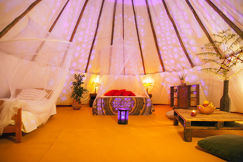 TEEPEE TENT    - CA. 150 METER AWAY FROM MAIN BUILDING / THROUGH NATURE PATH   - SHARED TENT EXPERIENCE (MAX 3 PEOPLE)  - TWIN BED  - GENDER NEUTRAL ROOM  - DRY TOILET  - COMMUNAL INDOOR SHOWER / TOILET AVAILABLE IN MAIN BUILDING (150METER AWAY)  - BRING FLASHLIGHT FOR THE PATH :-)   PRICE: 950 EUR / PER PERSON