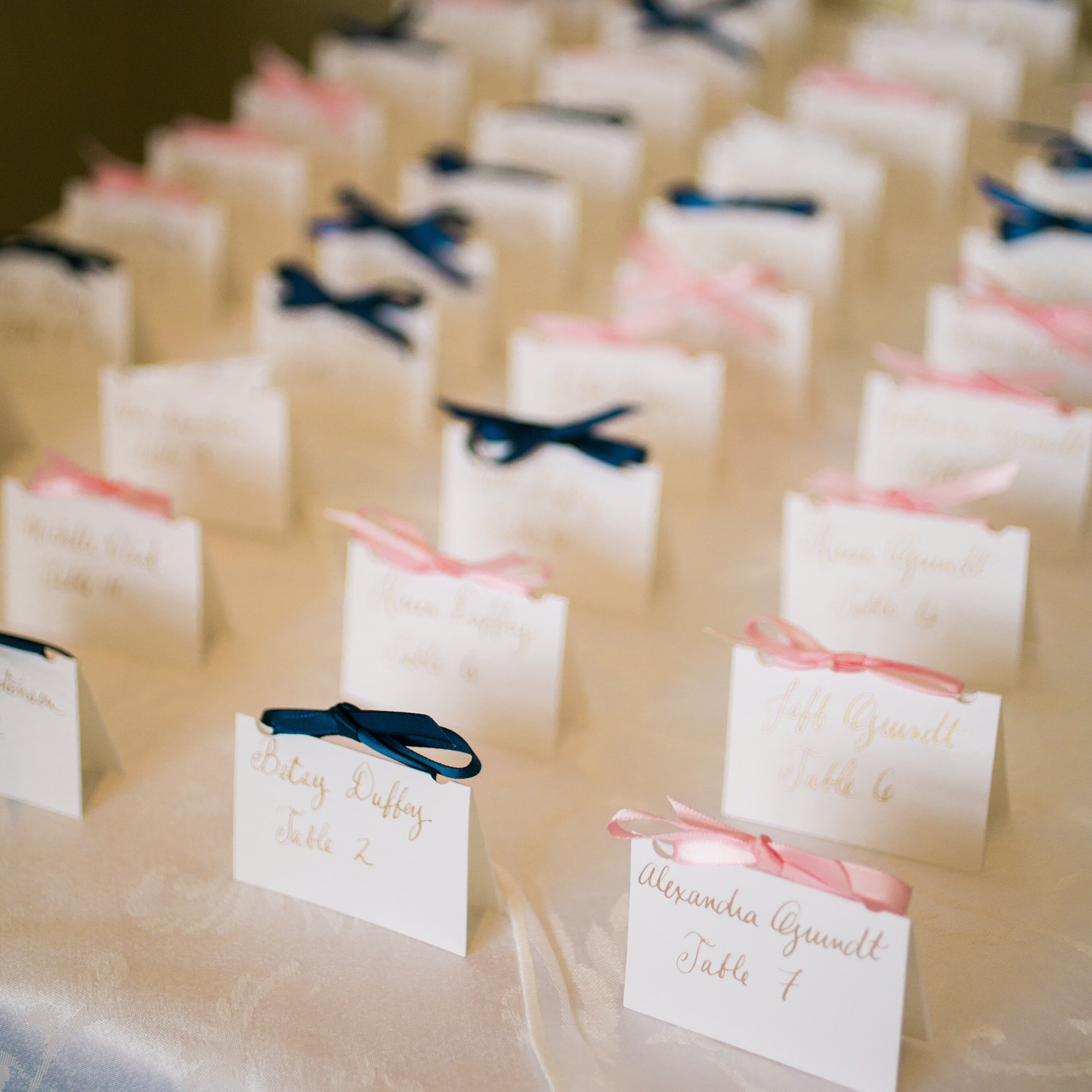 White place cards with gold calligraphy :: Opaline Lettering