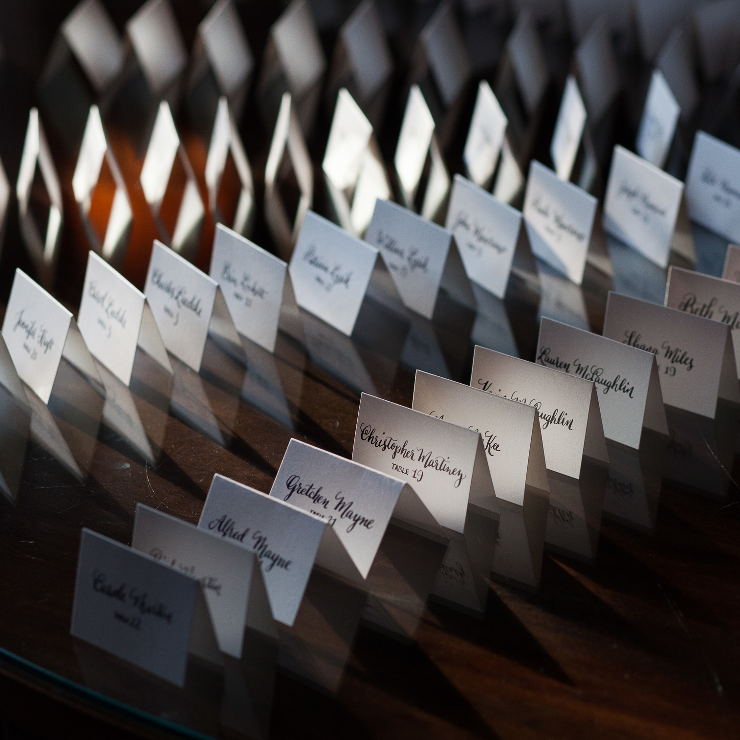 Shimmery white place cards with black calligraphy :: Opaline Lettering
