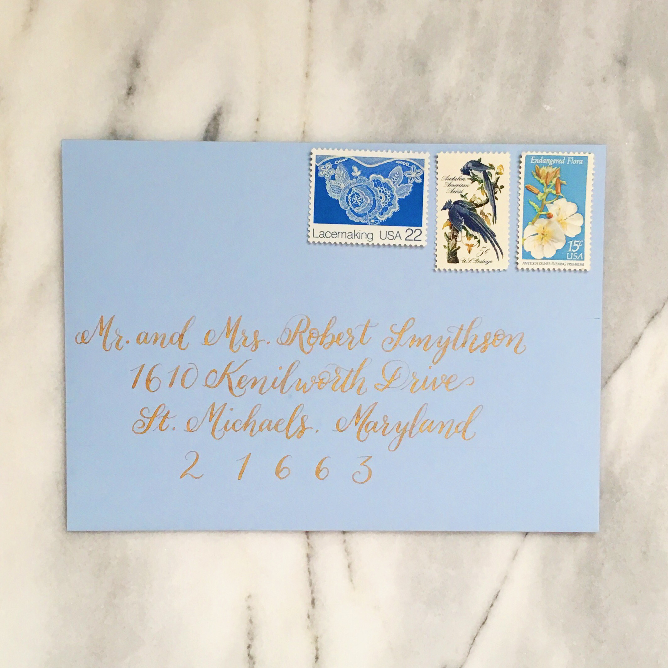 Light blue envelope with gold calligraphy :: Opaline Lettering