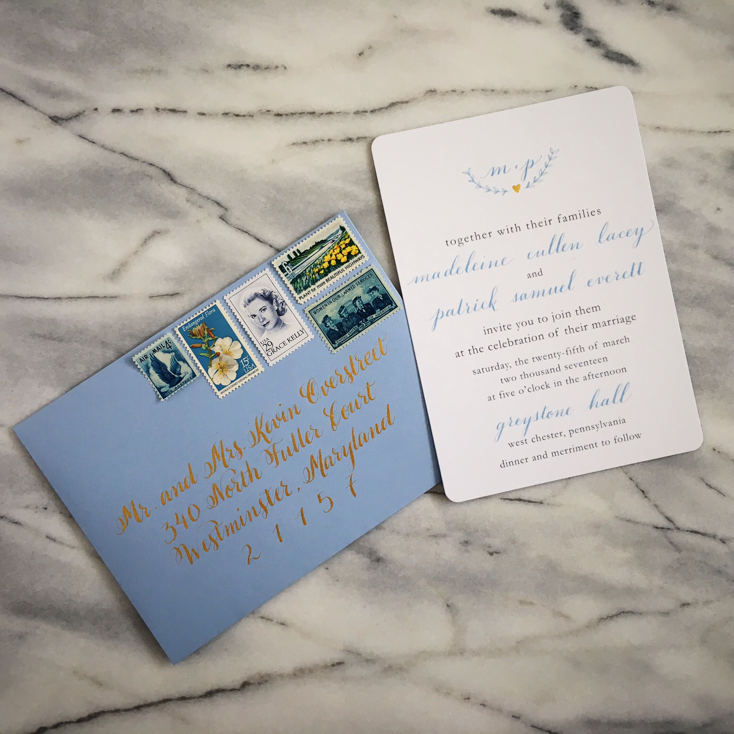 Light blue envelope with gold calligraphy and wedding invitation :: Opaline Lettering