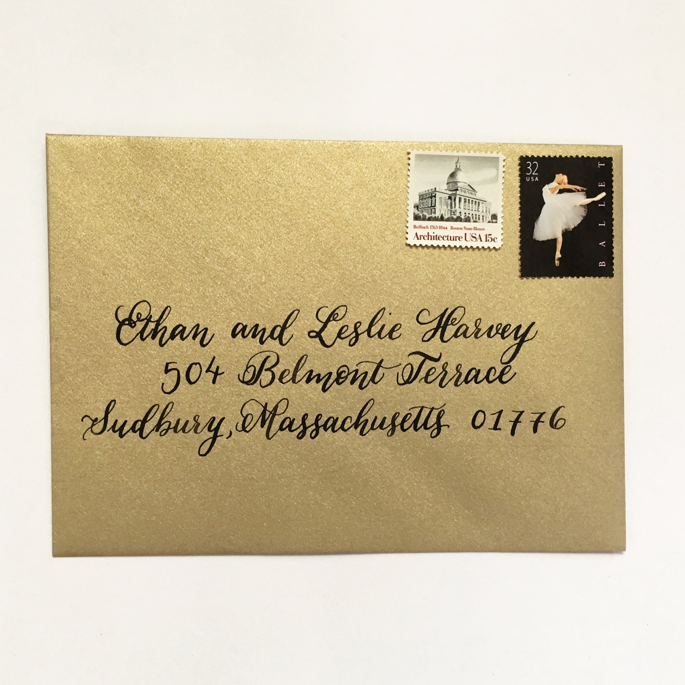 Gold envelope with black calligraphy :: Opaline Lettering