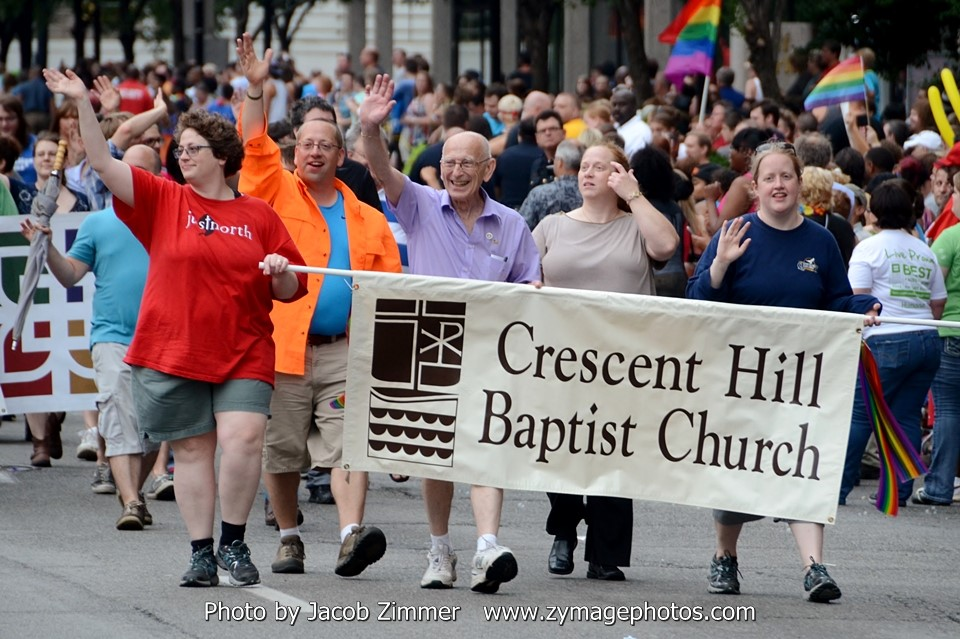 "Photo credit: Jacob Zimmer | Leach representing Crescent Hill Baptist Church at a 2014 pride parade, with daughter, Dawn on left in red; son, Seth in orange;  and daughter, Kimberly, with ""no premonition I was marching for myself,"" he wrote."