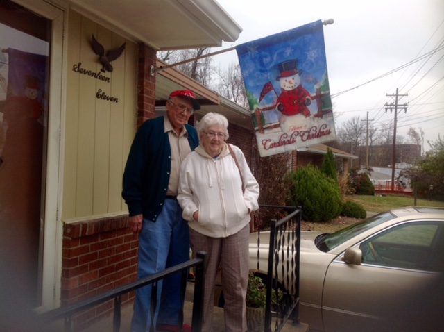 Roland and Earlene in front of the house they've lived in nearly 60 years.