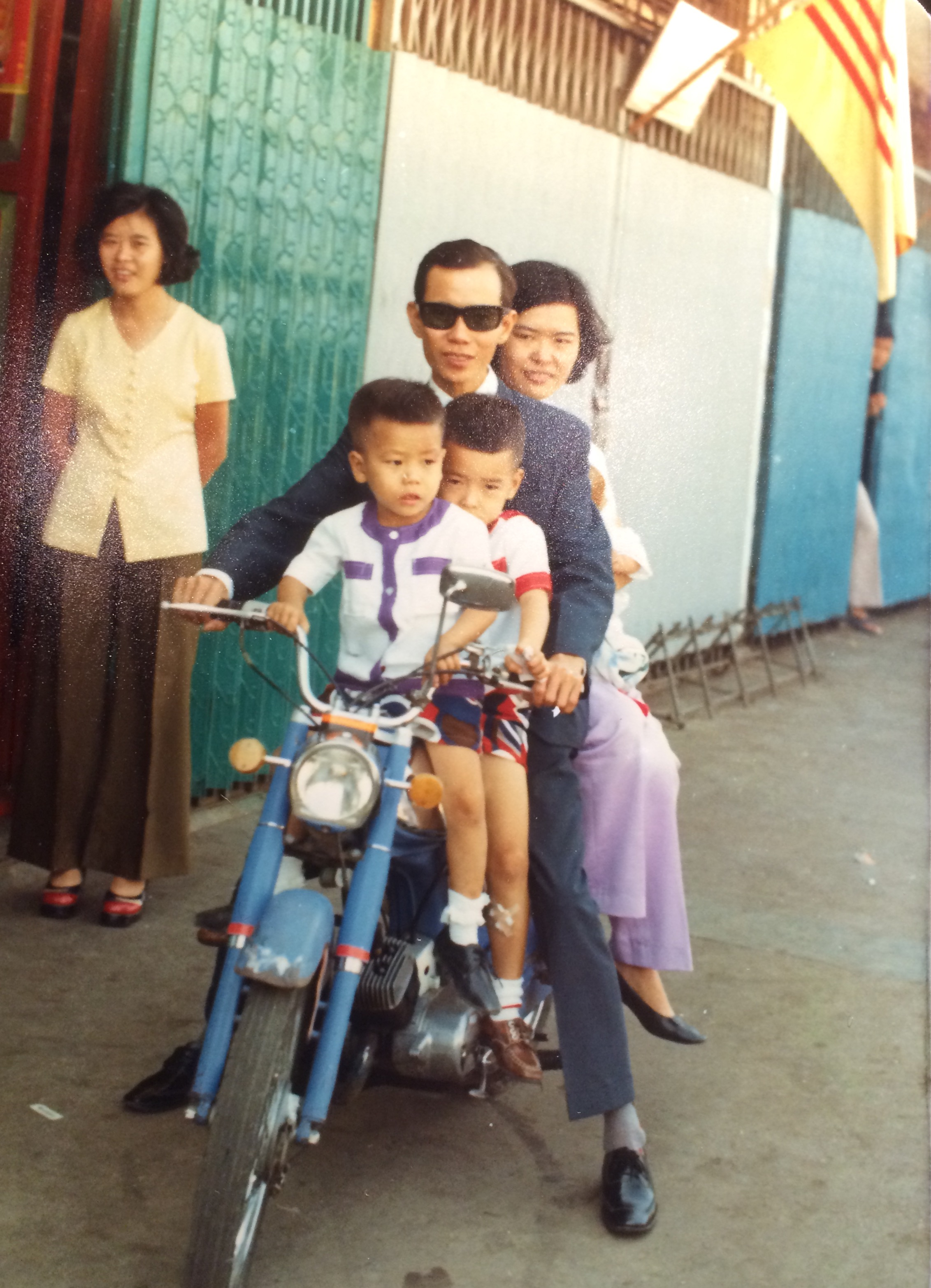 Lam and Ann Lo take the boys for a ride, early 1970s, Saigon.