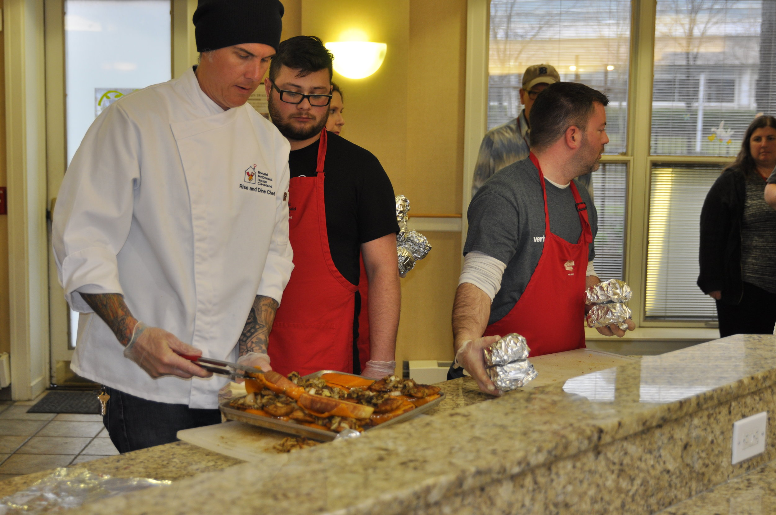 Matt Fish leads a RISE & Dine with volunteers from Verizon Wireless of Mentor.