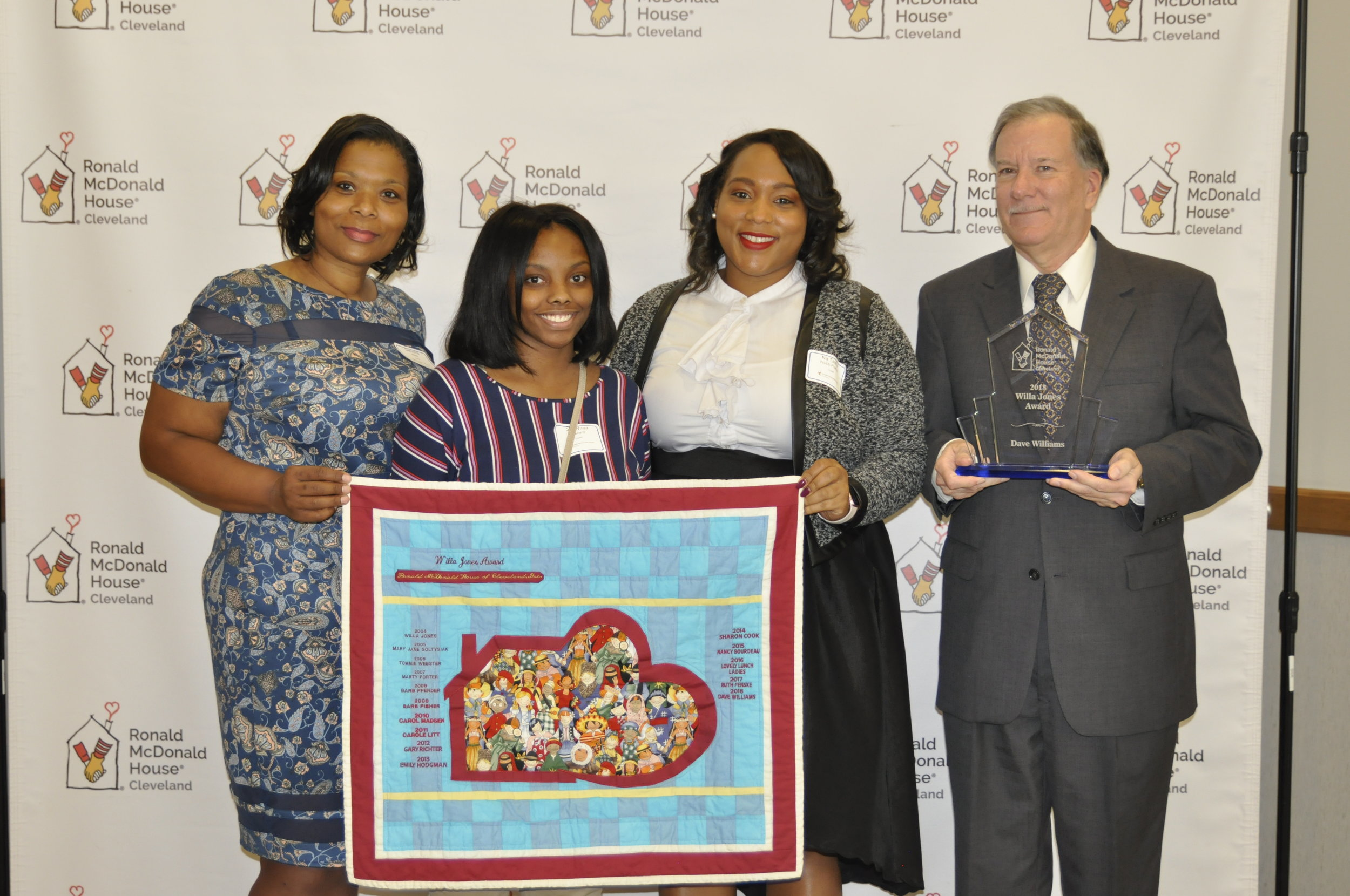 Willa Jones' granddaughter, great-granddaughter, and great-great-granddaughters Demetria Webb, Na'Tasha Webb-Prather, and Sha'Naya Howard with 2018 Willa Jones Award Honoree, Dave Williams.