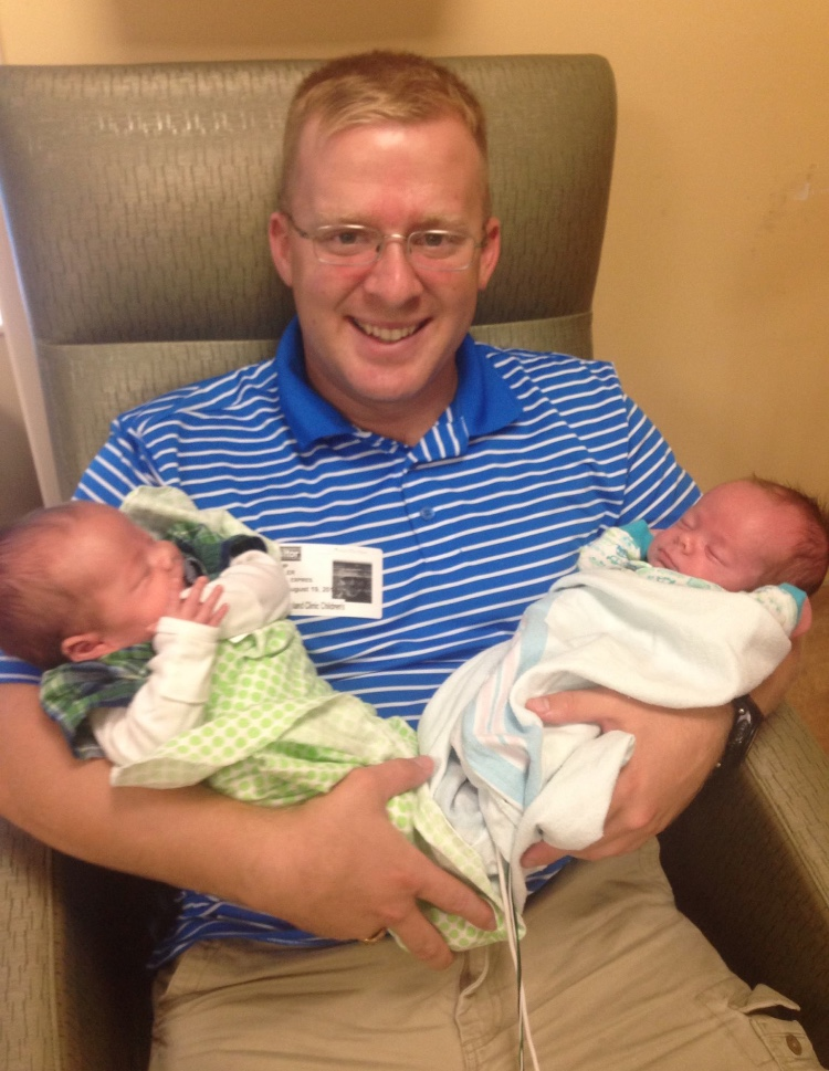 Philip holds his sons together for the first time