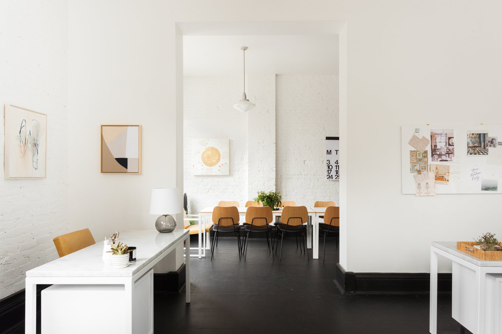 the-office-had-previously-housed-an-architecture-firm-that-had-implemented-a-high-contrast-palette-of-white-brick-walls-and-black-painted-trim-and-flooring-aesthetically-our-two-goals-with-the-interior-were-to-bring-a-little-warmth-to-the-b.jpg