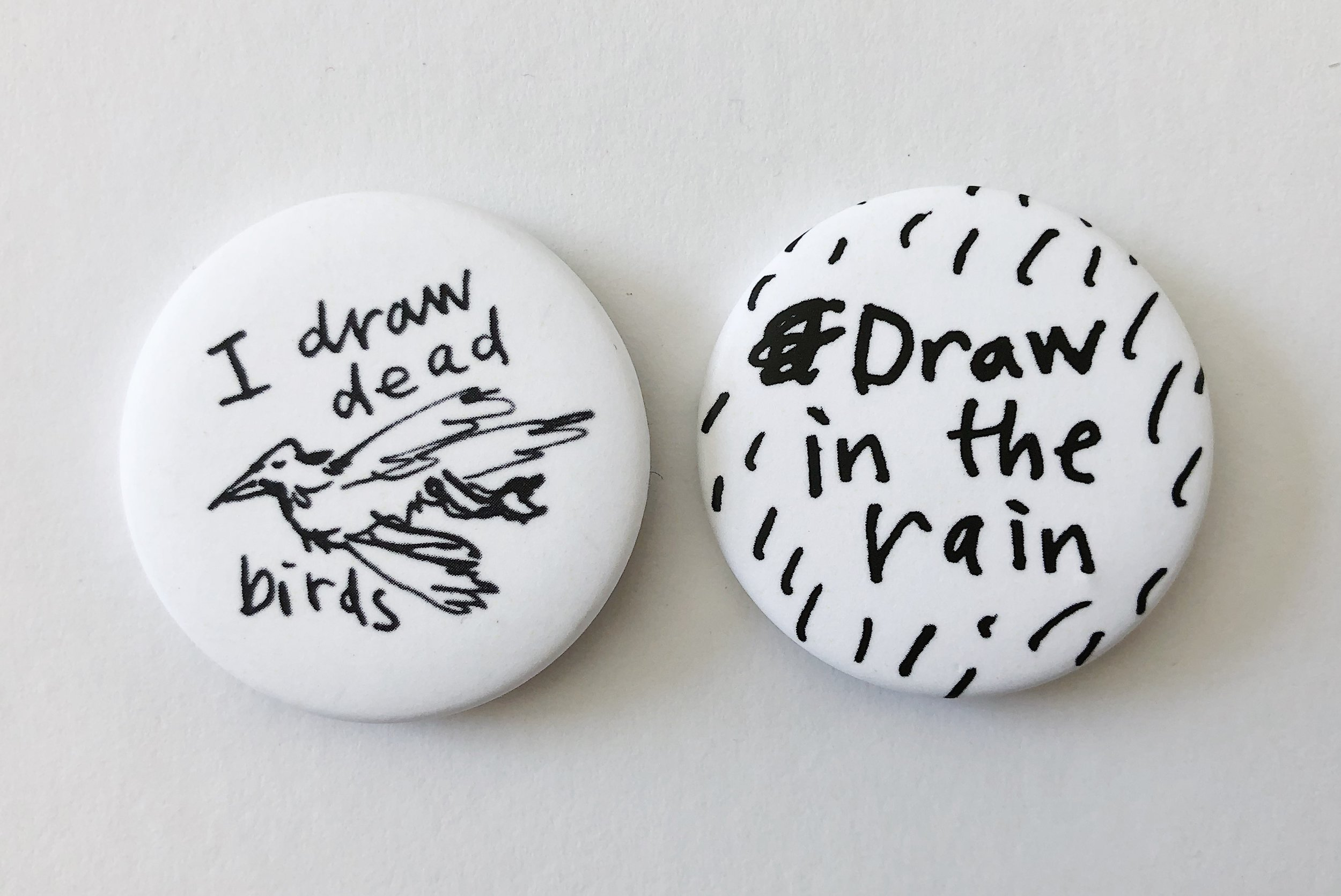 I draw dead birds and Draw in the rain badges.