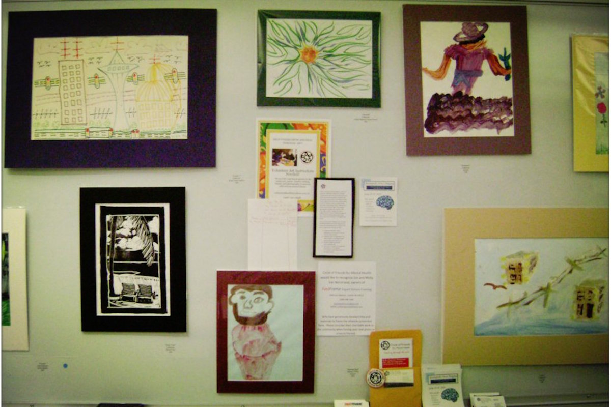 Artwork from Circle of Friends participants featured at a 2013 art show. (Photo via Circle of Friends for Mental Health Facebook page)
