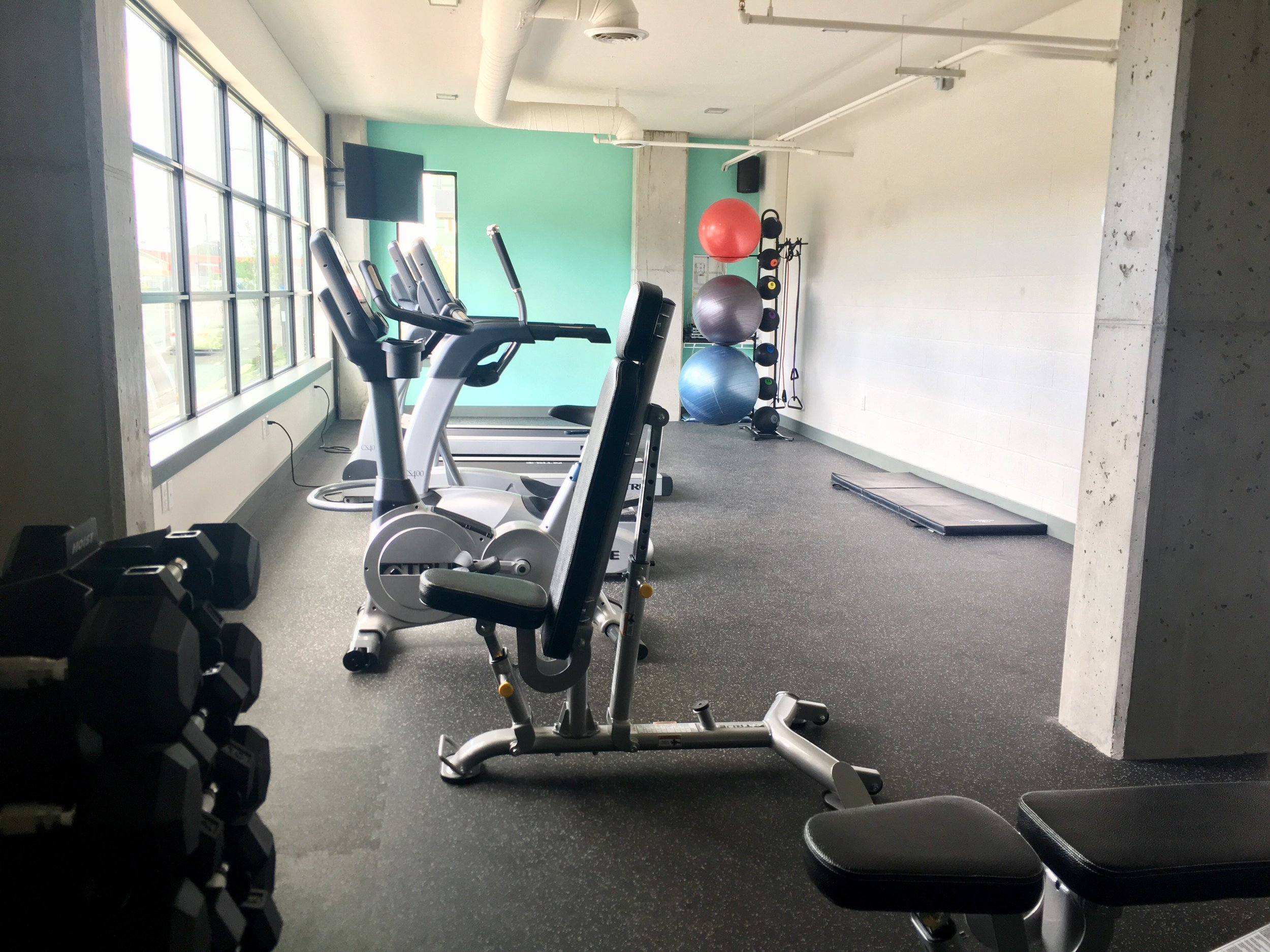 convenient fitness - The Chelsea's fitness room is designed for residents who want to stay in shape, but also need the convenience of a quick and close workout location. The space is full of natural light and offers an array of new equipment. You can have your heart rate up and be ready for work or school before you can say