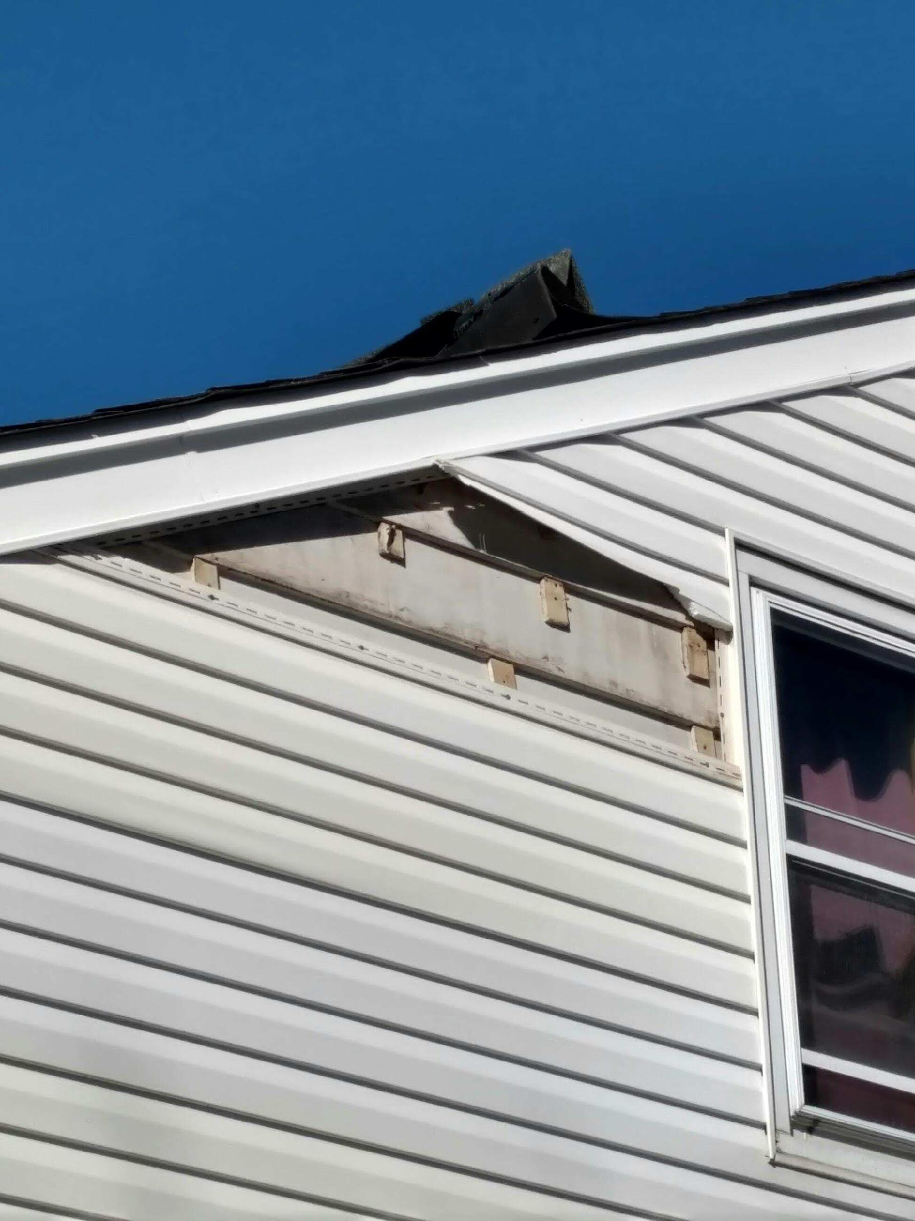 Common signs of wind damaged siding include: Missing, Torn, Broken, Dented or Hanging pieces and Debris from siding material, including fascia, soffit, and gutters.