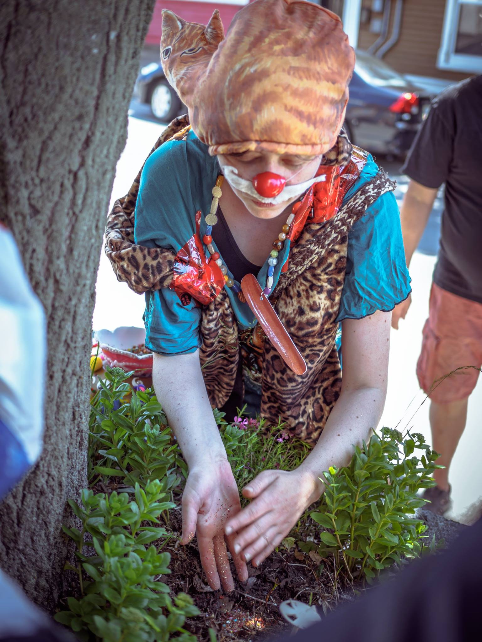 Wiener Shaman plants a Sacred Mixture of plant seeds, glitter, bacon bits, and ashes of fellow clown and artist, David Tuck. Photo by Ritchie Perez.