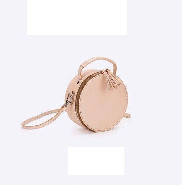 Round shoulder bag  by Apipi Leather