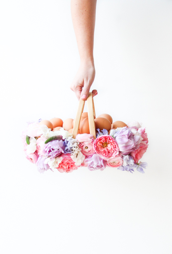 holding-fresh-flower-basket-filled-with-brown-eggs