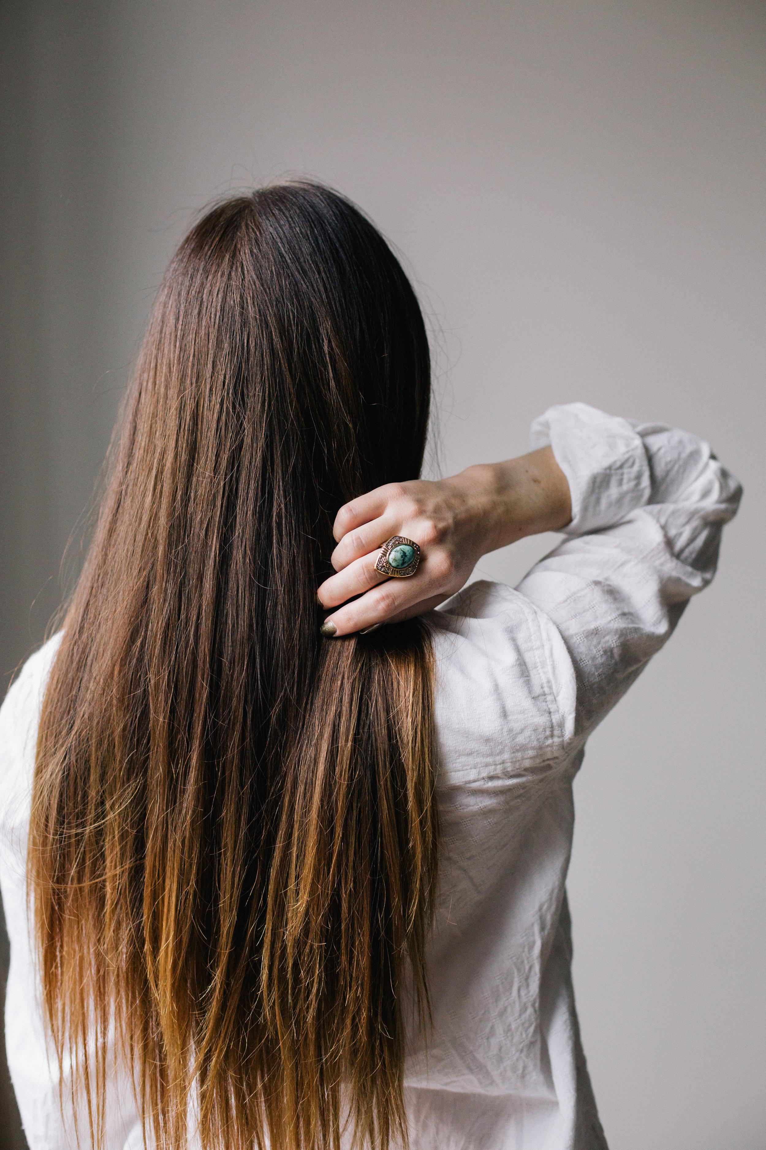 Long Brunette Hair Girl with Arm Behind Her.jpg