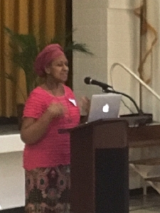 Blurry Image of Paulette Addressing Women's Group in Long Island