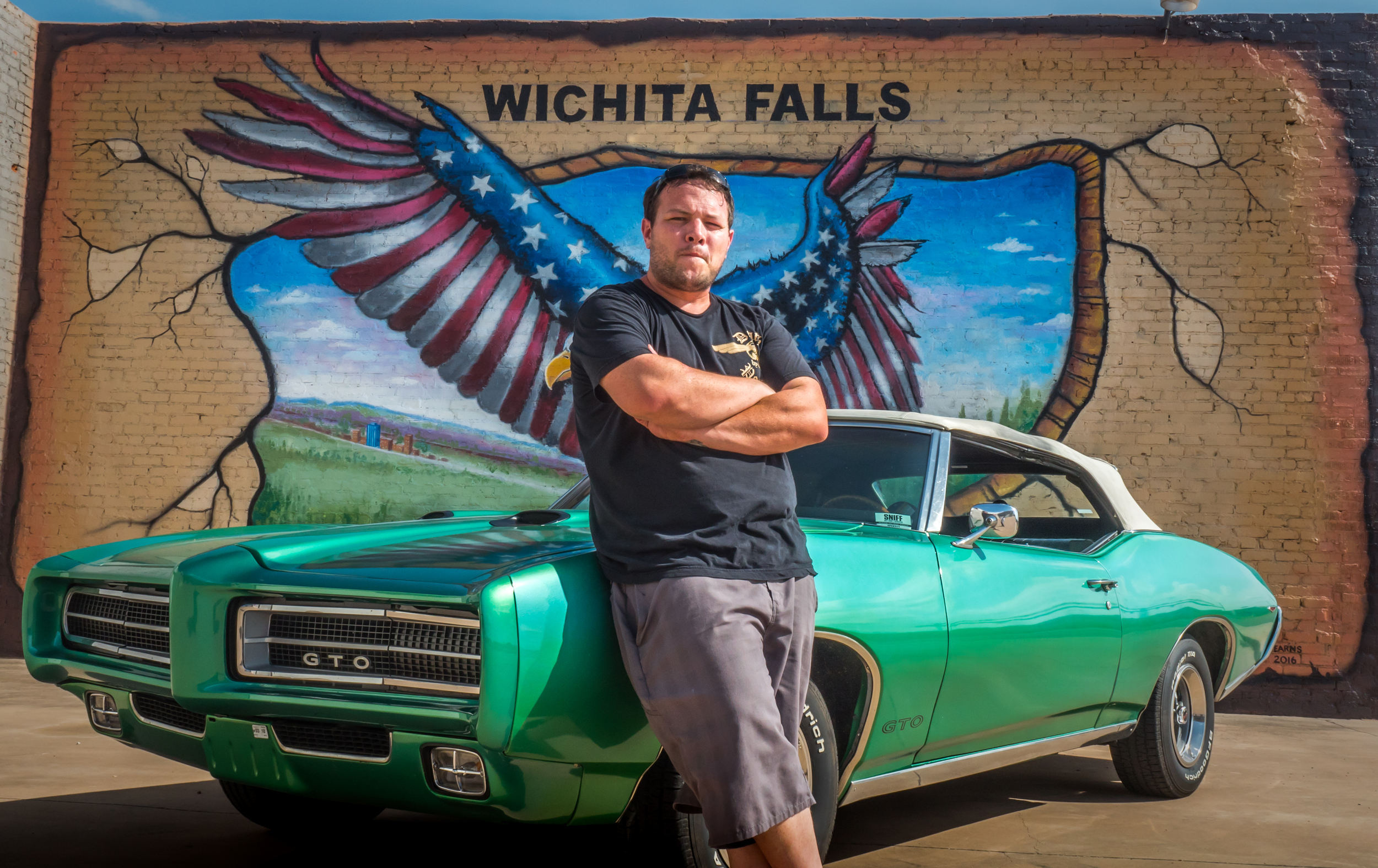 Mr. Brett Humpert with his 1971 GTO. Wall mural by Mr. Ralph Stearns. Downtown Wichita Falls, Texas. ©SimeonHendrix