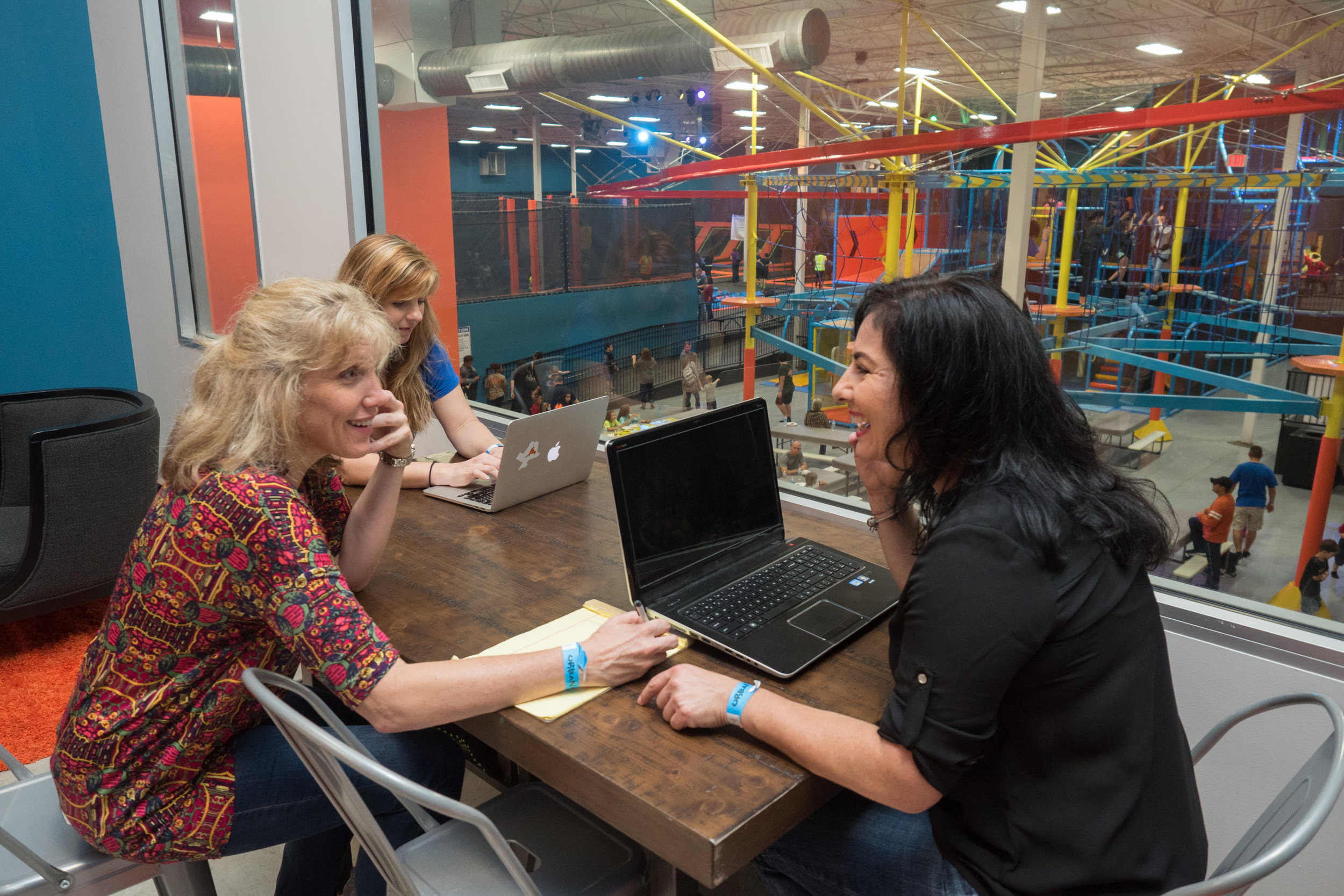 Moms have business meetings while kids play at Urban Air in Sugar Land, Tx