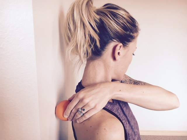 Pin the lacrosse ball between the wall and inside border of the shoulder blade, move the arm up and down and side to side across the body.