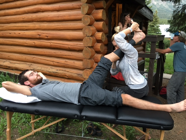 Dr. Jess getting some field PT and tissue work done on Dave Laufenberg. Cooke City. 215 miles in.