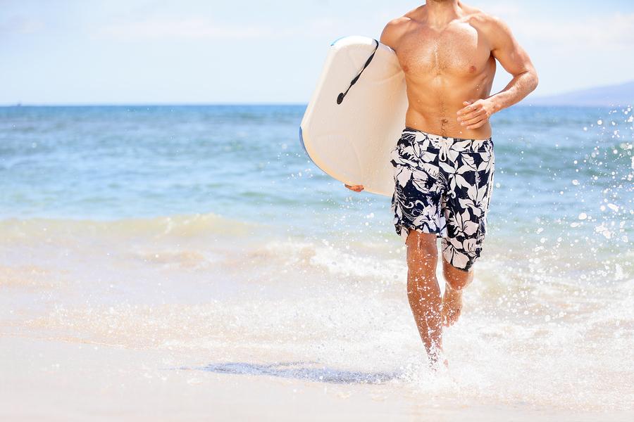 bigstock-Beach-fun-surfer-man-running-w-43917196.jpg
