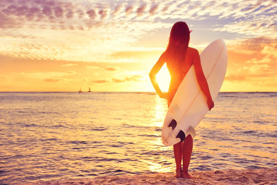 bigstock-Surfer-girl-surfing-looking-at-85475813.jpg