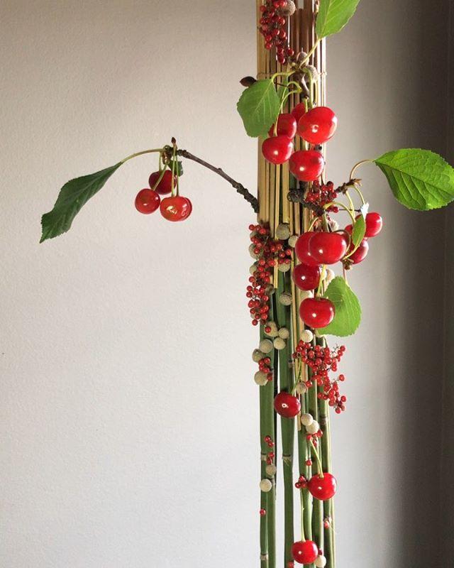 Equisetum, berzillia, pepper berry, and sour cherry.  Rhythm & repetition. Vertical line and spherical forms.  #floralart #havingfunwithdesign #principlesandelementsofdesign #pauljarasfloraldesign #studywithpaul #lifeisabowlofcherries🍒