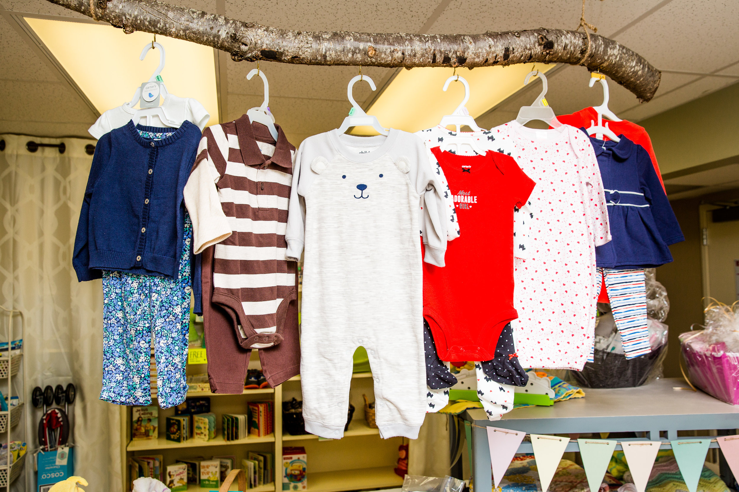 Baby Boutique clothing hanging on limb.jpg