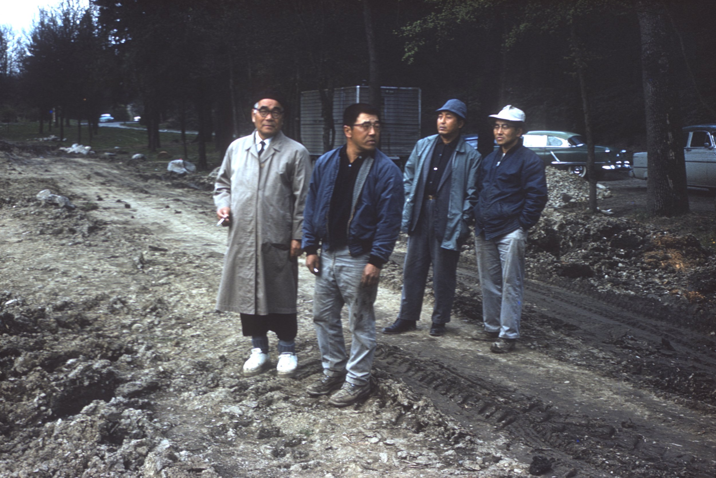 A rare color photograph of Juki Iida (left) with Kaz (Kei) Ishimitsu, Richard (Dick) Yamasaki, and William (Bill) Yorozu, taken during the construction of the Seattle Japanese Garden from 1959 to 1960 (photo undated).