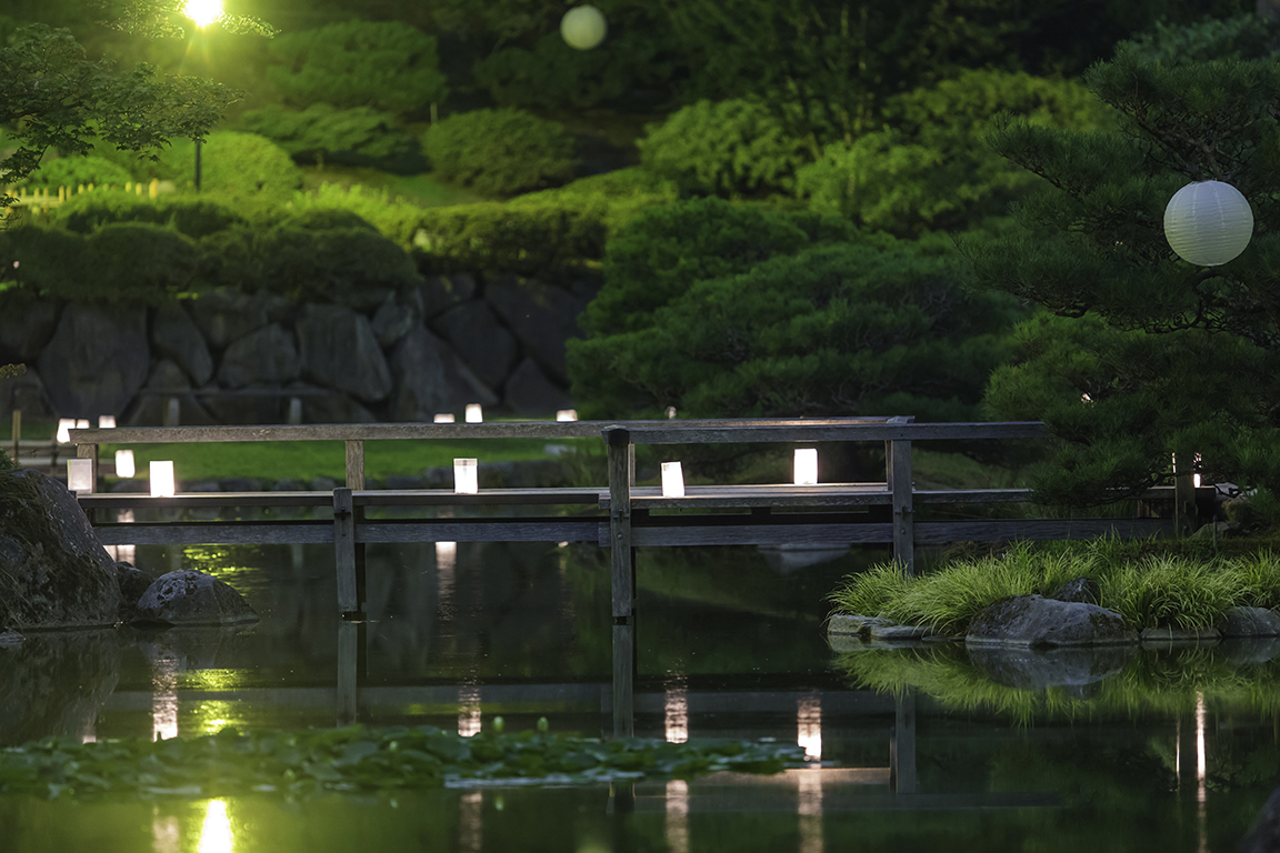 Luminaries reflecting on water (Photo by SlickPix Photography)