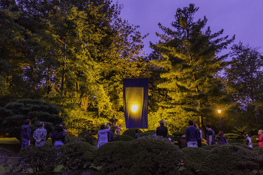 Guests watching a butoh dancer interact with the art installation (Photo by SlickPix Photography)