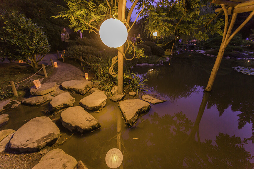 Paper lanterns placed along the paths illuminate the garden (Photo by SlickPix Photography)