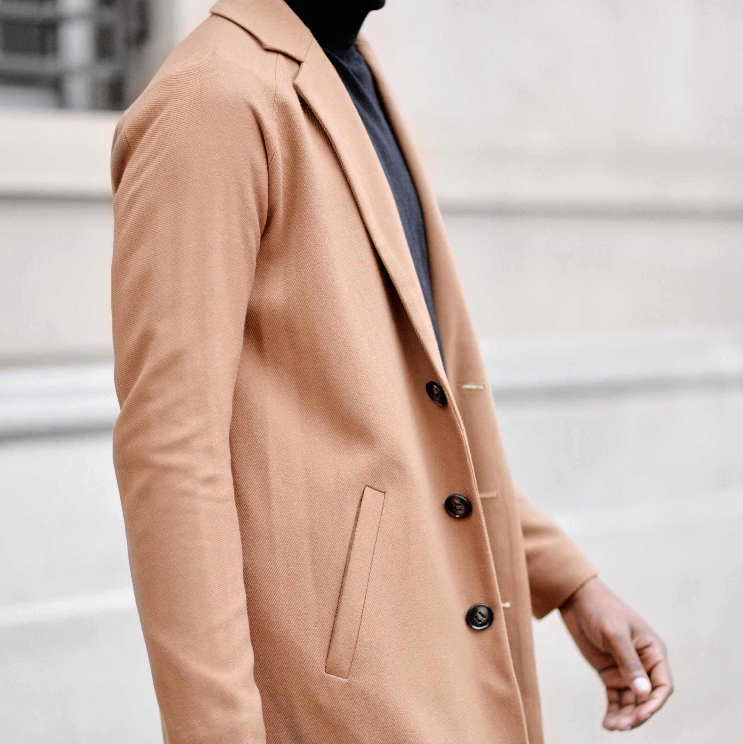 Tan overcoat and turtleneck