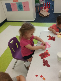Leaf cutouts were given to the children to decorate with fall colored paper. For a new tactile experience the children were able to squeeze their own glue and apply the colored paper where they wanted.
