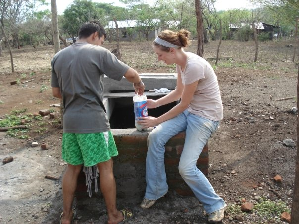 Audrey receiving a lesson in organic farming as a volunteer with Cristosal in Usulutan.